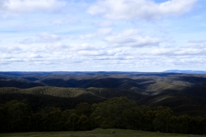 View from Mt Blackwood across the Lerderderg valley, with medium cloud cover and associated shade on valley.
